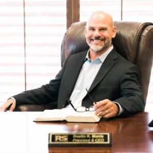 Dustin K. Manis President & CEO
